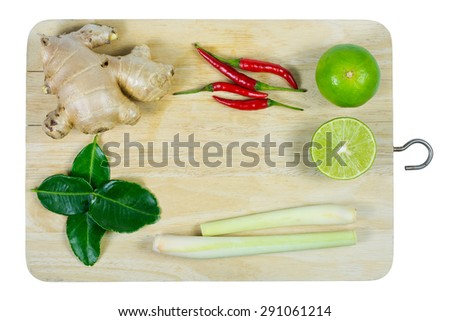 kaffir lime leaf, lemon, lemongrass, galangal, chili, herb and spicy ingredients for making Thai food on wood background. - stock photo