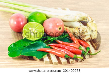 kaffir lime leaf, lemon, lemongrass, galangal, chili, herb and spicy ingredients for making Thai food on wood background.