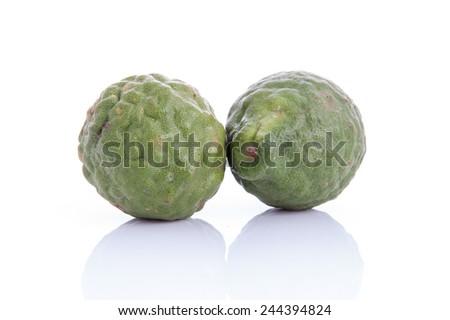 kaffir lime on white background - stock photo
