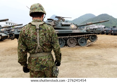 KAGAWA, JAPAN - APRIL 29 : The celebration day of military base was made in Kagawa Prefecture. Military vehicle marches for a parade. Apr 29, 2014 in Kagawa, Japan. - stock photo