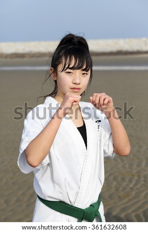 KAGAWA, JAPAN - Jan 3: Japanese karate girl of fighting-pose in midwinter at Ichinomiya Beach, January 3, 2016, Kagawa, Japan