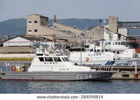 KAGAWA, JAPAN - JUNE 01: Japanese police high speed patrol boat. Japan coast guard. Sakaide-harbor, Kagawa, Japan on Jun 01, 2015. - stock photo