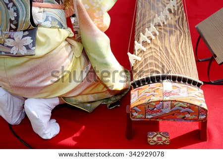 KAGAWA, JAPAN - NOVEMBER 22: Japanese women dressed in traditional kimono clothing playing the koto (Japanese traditional instrument). November 22, 2015 in Kagawa, Japan.