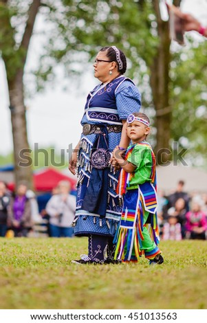 Kahnawake, Quebec, Canada - July 10, 2016 : Pow wow dancers take part in Kahnawake 26th Annual Echoes Of A Proud Nation Pow Wow in Kahnawake reserve
