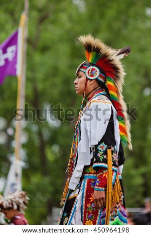 Kahnawake, Quebec, Canada - July 10, 2016 : Pow wow Fancy dancer taking part in Kahnawake 26th Annual Echoes Of A Proud Nation Pow Wow in Kahnawake reserve