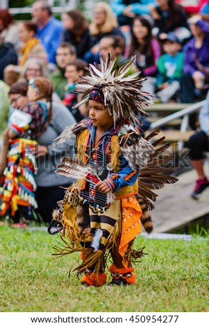 Kahnawake, Quebec, Canada - July 10, 2016 : Pow wow tiny tot boy dancer take part in Kahnawake 26th Annual Echoes Of A Proud Nation Pow Wow in Kahnawake reserve