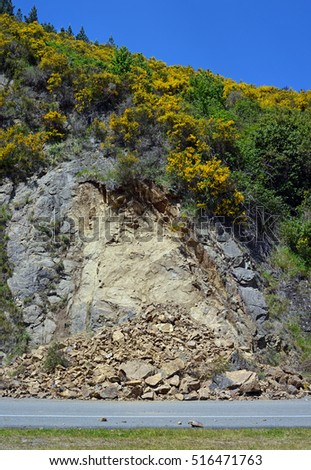 Kaikoura, New Zealand - November 15, 2016: Slips and rock slides line Highway One in  North Canterbury after the 7.5  Kaikoura Earthquake. Rocks, the size of cars,  continue to fall this week.