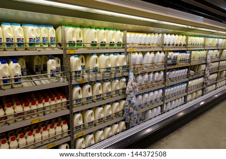 KAITAIA, NZ - JUNE 21:Milk fridge on June 21 2013.The income from dairy farming is now a major part of the New Zealand economy, becoming an NZ$11 billion industry by 2010. - stock photo