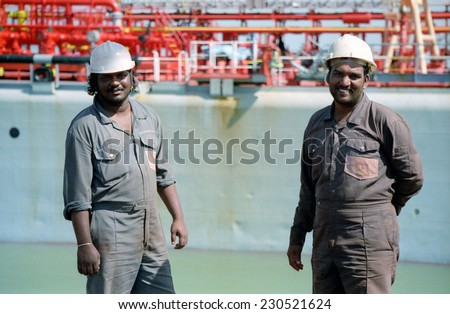 KAKINADA, INDIA - JANUARY 30, 2013: Harbor workers in the port of Kakinada, India on January 30th , 2013. The port increased in commercial activity due to India's significant economic growth - stock photo