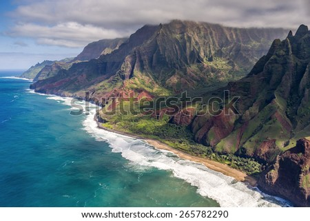 Kalalau valley on the Na pali coast from a doors off helicopter tour of Kauai, Hawaii - stock photo