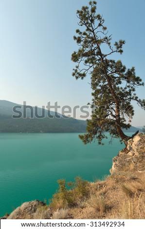 Kalamalka Lake near Vernon in sunny day - stock photo