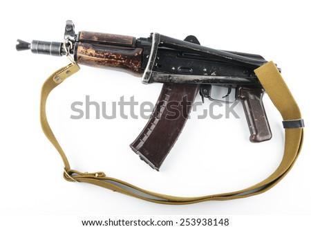 Kalashnikov rifle on bright background. - stock photo