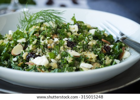 Kale and quinoa salad with dill vinaigrette and almonds - stock photo
