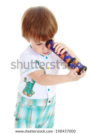Kaleidoscope enthusiastically holding small, charming blond boy. on a white background - stock photo