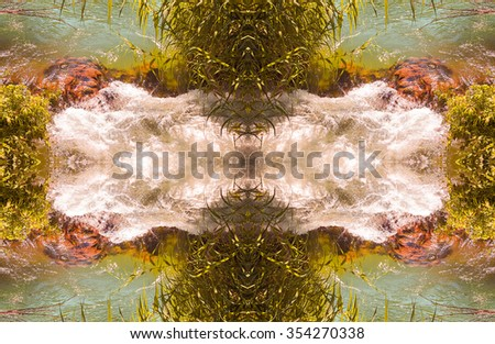 Kaleidoscopic pattern of water stream in summer framed with green plants  - stock photo