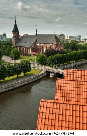 Kaliningrad, Russia - June 21, 2010: Historical center and Cathedral Church on Kant island in Kaliningrad, UNESCO World Heritage Site. View from lighthouse - stock photo