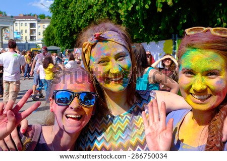KALININGRAD, RUSSIA - JUNE 12, 2015: Unidentified girls during Holi Festival of Colors, the event is timed to the Day of Russia. - stock photo