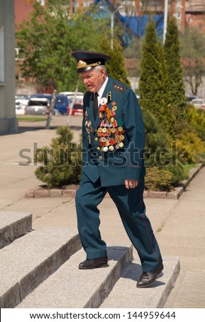 KALININGRAD, RUSSIA - MAY 07: veteran of the World War II with his medals walked at street on during the victory celebration in World War II on May 07, 2013 in Kaliningrad, Russia