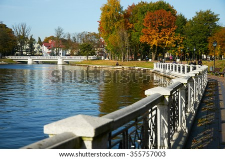 KALININGRAD, RUSSIA - OCT 15, 2015: People walking on a sunny autumn day on the banks of the Verkhnee lake