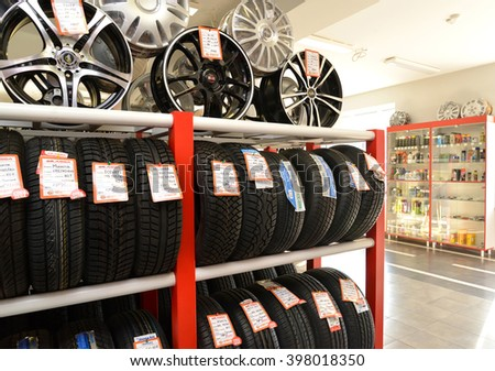 KALININGRAD, RUSSIA - OCTOBER 03. 2015: A rack with tires and rims in a trading floor. Shop of an autotechnical center - stock photo
