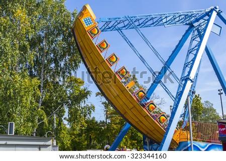 KALININGRAD, RUSSIA - OCTOBER 03,2015: Boat carousel in the Park of Kaliningrad - stock photo