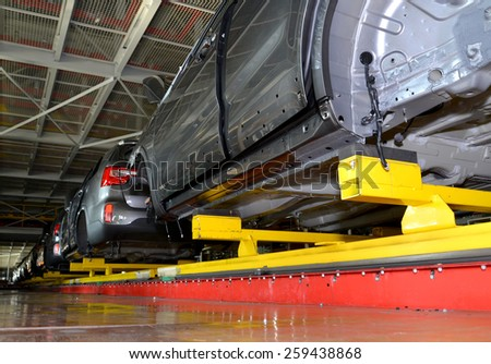 KALININGRAD, RUSSIA - SEPTEMBER 16, 2014: Cars stand on the conveyor line of assembly shop. Automobile plant