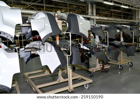 KALININGRAD, RUSSIA - SEPTEMBER 16, 2014: Rear bumpers of a body of the car on supports in assembly shop of the automobile enterprise