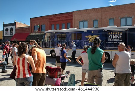 KALISPELL, MT, USA - JULY 4: US Congressman Ryan Zinke (R-MT) waves at the crowd while marching with his campaign bus at the 4th of July Parade in Kalispell, Montana, on July 4, 2016.