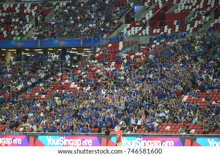 Kallang-SINGAPORE-29jul,2017:Unidentified fans perform a mexican wave during icc 2017 between chelsea and FC internazionale at national stadium,singapore
