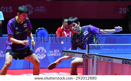 KALLANG,SINGAPORE-JUNE1:Chaisit.C and Nikom.W of Thailand in action during the 28th SEA Games Singapore 2015 between Thailand and Indonesia at Singapore Indoor Stadium on June1 2015 in SINGAPORE.  - stock photo