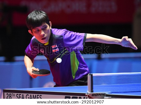KALLANG,SINGAPORE-JUNE1:Nikom.W of Thailand in action during the 28th SEA Games Singapore 2015 between Thailand and Indonesia at Singapore Indoor Stadium on June1 2015 in SINGAPORE.