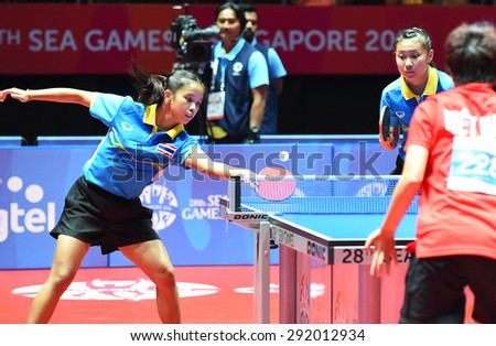 KALLANG,SINGAPORE-JUNE1:Orawan.P and Tamolwan.K of Thailand in action during the 28th SEA Games Singapore 2015 between Thailand and Vietnam at Singapore Indoor Stadium on June1 2015 in SINGAPORE. - stock photo