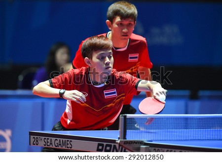 KALLANG,SINGAPORE-JUNE1:Padasak.T and Chanakran.U of Thailand in action during the 28th SEA Games Singapore 2015 between Thailand and Cambodia at Singapore Indoor Stadium on June1 2015 in SINGAPORE.  - stock photo