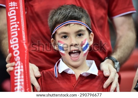 Kallang,Singapore - JUNE 15:Unidentified fan of Thailand national supporters during the 28th SEA Games Singapore 2015 match between Thailand and Myanmar at Singapore National Stadium on JUNE15 2015