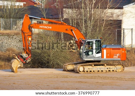 KALLINGE, SWEDEN - FEBRUARY 07, 2016: Hitachi Zaxis 250 lcn crawler excavator at work at a construction site.