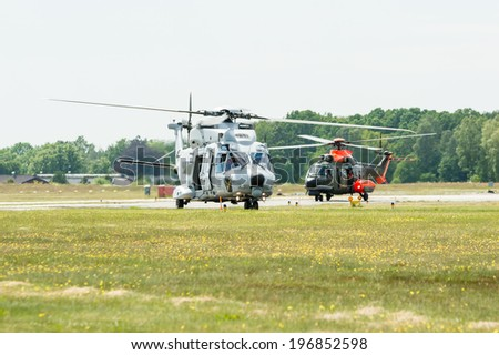KALLINGE, SWEDEN - JUNE 01, 2014: Swedish Air Force air show 2014 at F 17 Wing. NHIndustries NH90 and Super Puma  helicopters on runway.
