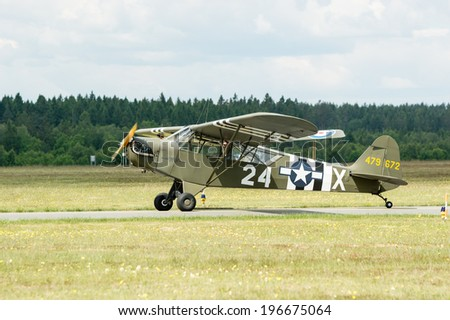 KALLINGE, SWEDEN - JUNE 01, 2014: Swedish Air Force air show 2014 at F 17 Wing. Piper J-3 Cub painted with war stripes. On ground.