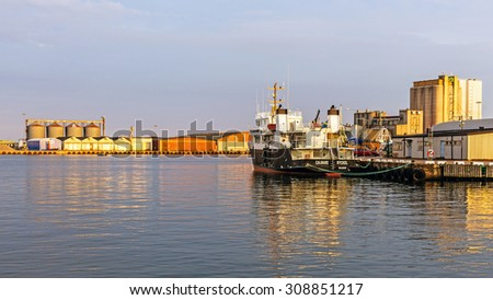 KALMAR, SWEDEN - AUGUST 8, 2015: Ship moored in the Port of Kalmar. The port owned by the municipality of Kalmar handles 1 million tons of goods per year mainly petroleum, forestry and agricultural.
