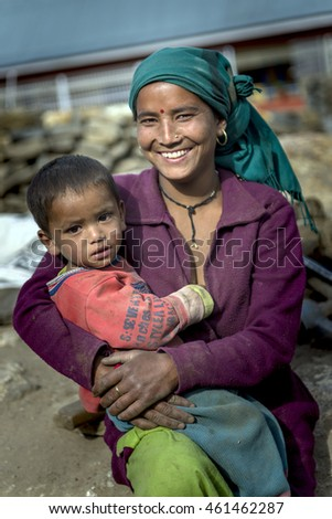 KALPA, INDIA - Jun 06, 2016: A child with his young loving mother after breast feeding session, Himachal Pradesh.