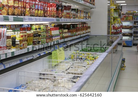 Kaluga, Russia - April, 21, 2017: Interior of a supermarket in Kaluga, Russia with refregerator on a frontground