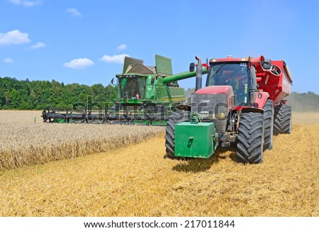 Kalush, Ukraine - AUGUST 11: Modern combine harvesting grain in the field near the town Kalush, Western Ukraine August 11, 2014 - stock photo