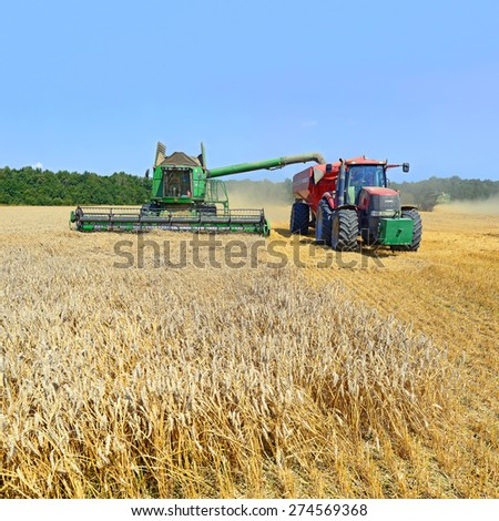 Kalush, Ukraine - AUGUST 11: Modern John Deere combine harvesting grain in the field near the town Kalush, Western Ukraine August 11, 2014  - stock photo