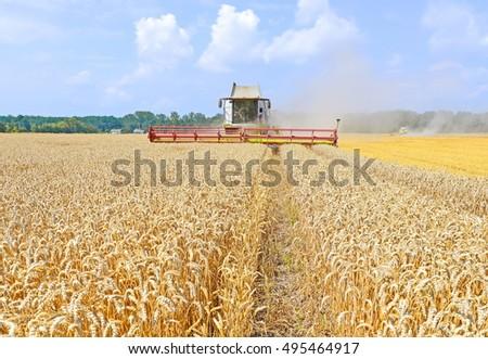 Kalush, Ukraine - July 28: Modern  combine harvesting grain in the field near the town Kalush, Western Ukraine July 28, 2016