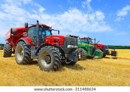 Kalush, Ukraine - July 17: Wheeleds tractors in the field near the town Kalush, Western Ukraine July 17, 2015