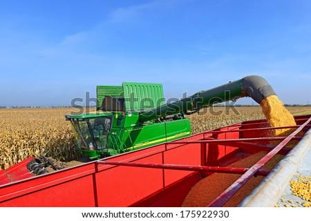 Kalush, Ukraine -Â?Â? OCTOBER 8: Modern John Deere combine harvesting corn in the field near the town Kalush, Western Ukraine October 8, 2013.   - stock photo
