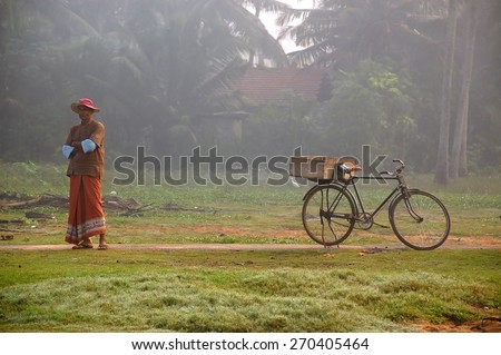 KALUTARA, SRI LANKA - DECEMBER 12: Local dealer waits for fishermen to get back from the sea with a good catch on a foggy morning December 12, 2008 Kalutara, Sri Lanka - stock photo