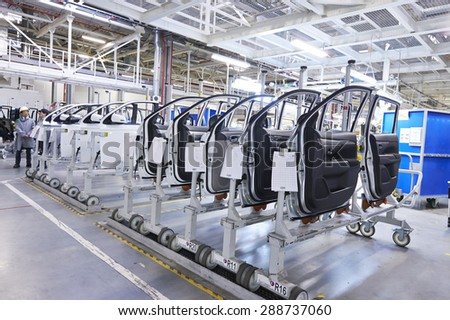 KALUZHSKY region, RUSSIA - JUNE 16: Body's parts (doors) prepared for installation at automotive Mitsubishi (PCMA) plant on june 16, 2015 - stock photo