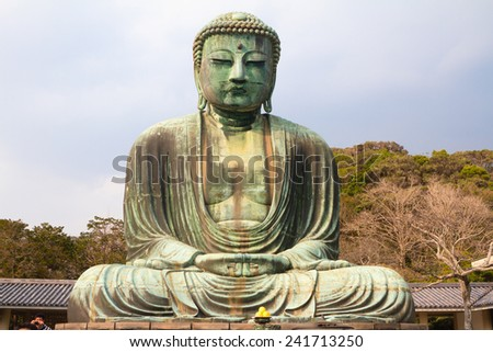 KAMAKURA, JAPAN - MARCH 10: The Great Buddha of Kamakura on March 10, 2013 in Kamakura, Japan. With a height of 13 meters, it is the second tallest bronze Buddha statue in Japan. - stock photo