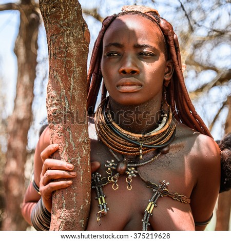 KAMANJAB, NAMIBIA - JAN 8, 2016: Unidentified woman from Himba tribe. The Himba are indigenous people living in northern Namibia and Angola - stock photo
