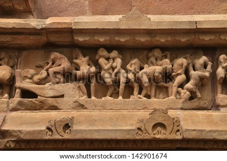 Kamasutra Carvings on Temple walls at Khajuraho AD 930-950 - stock photo